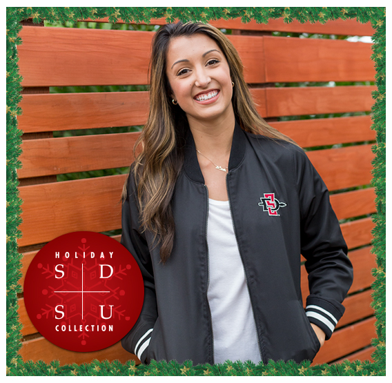 SDSU Holiday Collection. A photo of a female SDSU student in a SDSU Jacket.